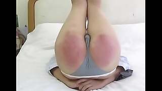 Hard Chinese spanking - paddle and carpet beater